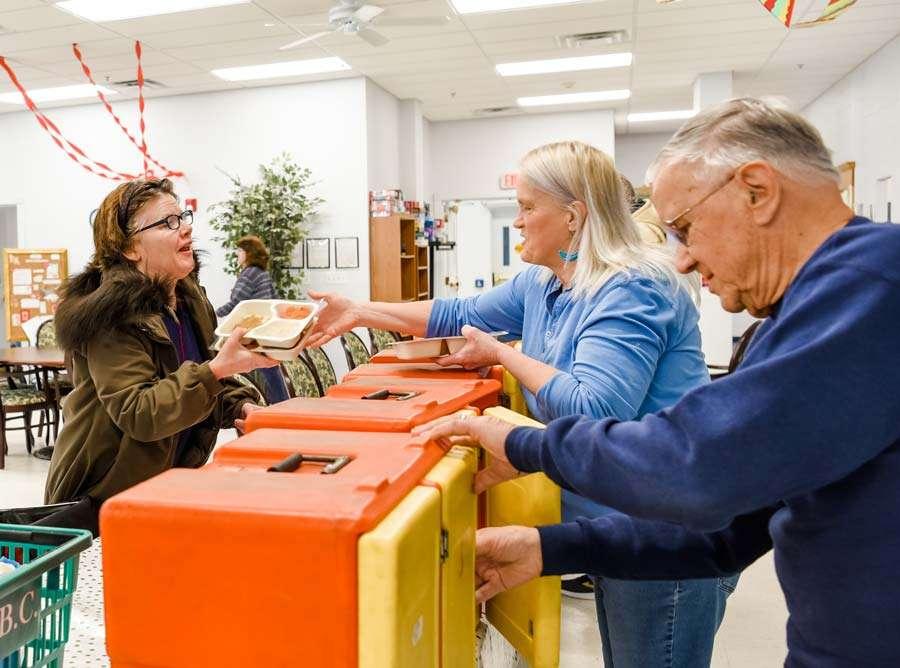 elderly volunteers helping at a food bank